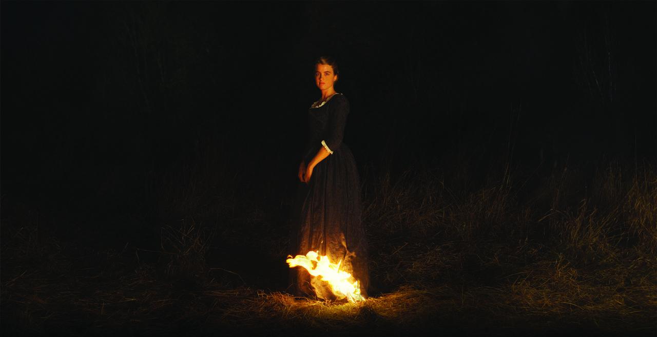 Porträt einer jungen Frau in Flammen - © Foto: Filmladen