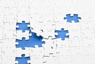 Puzzle - © Foto: iStock/atiatiati