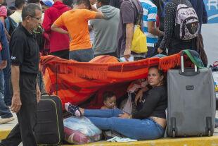 Lateinamerika Flüchtlinge - © Foto: APA / AFP / Cris Bouroncle