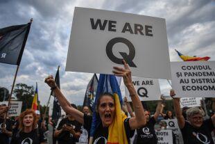 Qanon - © APA/AFP/Daniel MIHAILESCU