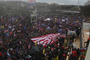 QAnon - © Foto: APA / AFP / Roberto Schmidt